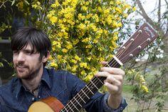 Seth Avett holding a Martin Guitar