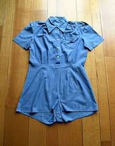 A vintage 1940s romper that was likely part of a uniform (the chambray material makes me think it might have possibly been part of a WWII workers uniform). The romper has gathering at the shoulders, bodice pocket, collar, vertical tucks at the waist (and no waist seam), buttons on the front bodice (including a tiny button at the neck) and at the bottom. The blue fabric feels like cotton chambray.