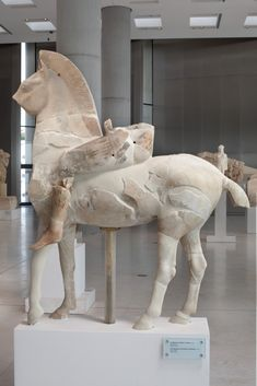 Male statues | Acropolis Museum. The Persian Horse rider The horse rider owes his name to his colourful oriental garment, a short chiton and pants (anaxyrides). 520-510 BC. Marble from Paros (Acr. 606)
