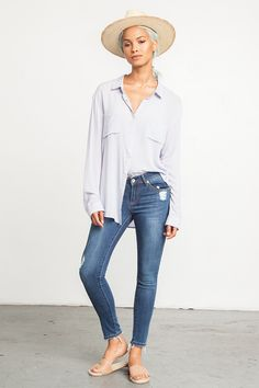 Cropped Skinny Jeans with Frays - Cool pair of skinny jeans that are cropped in length and feature frays at the bottom and distressing in various spots throughout.  Features just the right amount of stretch for the perfect fit.  Wear with a loose blouse for the perfect, off-duty look.