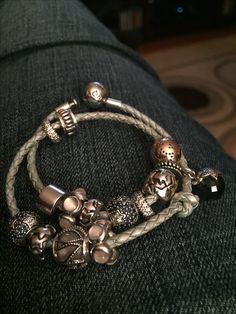 Pandora leather bracelet with star charms.