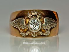 Very Rare Gold and Diamond Men's Ring and Russian Imperial Crest.  A 56 zolotniks rose gold ring is applied with a silver gilt Russian double headed Imperial eagle. The eagle is set with an antique cut brilliant diamond (approximately 0.65 ct).    made in Moscow between 1908 and 1917