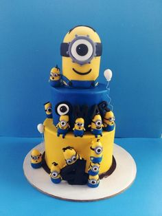 Children's Birthday Cakes - Minion theme birthday cake. The minions were all created using fondant