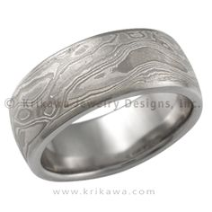 Wide Platinum Mokume Wedding Band - This mokume gane is made up of layers of three different metals: platinum, sterling and 14k palladium white gold. This extremely low contrast mokume needs to have an etch to best accentuate the contrast of colors of the metals. Our most subtle mokume for your wedding band. If you like a rugged look, but prefer a limited color contrast, the heavy etched Platinum Mokume Gane wedding band may be just for you. You will still have the woodgrain texture, but the…