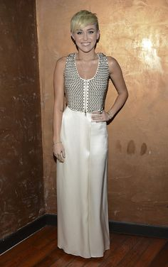 Miley Cyrus shows off slim figure in a cream and metallic creation at the City of Hope Gala in NY