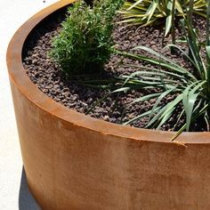 STREETLIFE Shurbtubs Cylindrical CorTen. These Shrubtubs made of thick-walled weathering steel can be easily moved and have internal anchor points for the tree root balls