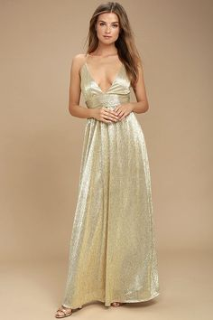 Lulus Exclusive! Shine like the siren you are in the Gilded Goddess Gold Maxi Dress! Metallic woven poly stuns across a plunging, triangle bodice, banded waist, and cascading maxi skirt. Adjustable skinny straps crisscross at back. Hidden back zipper.
