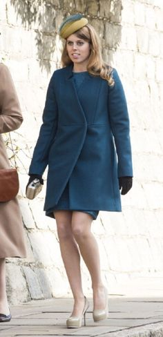 Princess Beatrice, wore a teal coat and mustard coloured fascinator with teal feather and cream shoes for the Easter Sunday service at Windsor Castle.