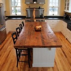 I love the use of reclaimed wide plank wood being used as a kitchen island. LOVE LOVE LOVE the top