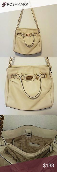 Michael Kors Bag White Michael Kors genuine leather handbag with gold details. Very minimal wear & tear, has been taken care of. Firm on price, no trades. Thank you! Michael Kors Bags