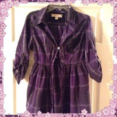 Cute purple shirt Good condition Tops