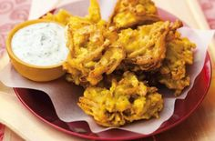 This classic onion bhaji recipe makes 8-10 good sized onion bhajis that are packed with classic Indian spices such as turmeric and ground cumin.