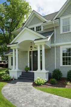 shingles painted with Benjamin Moore Thunder; trim color is Benjamin Moore OC 17 White Dove