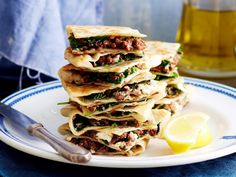 This gorgeous Turkish gozleme recipe is complete with a a buttery homemade pastry and a spicy lamb, spinach and feta filling. Serve with a drizzle of lemon for an easy lunch or dinner.