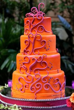 Beautiful cake design. The orange is a super pretty color. Don't know if I'd pair it with purple...or not that purple, maybe a really dark purple.