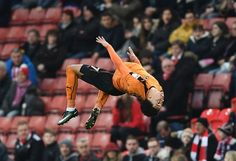 Hélder Costa of Wolverhampton Wanderers celebrates with team mates after scoring his sides first goal during The Emirates FA Cup Third Round match between Stoke City and Wolverhampton Wanderers at Bet365 Stadium on January 7, 2017 in Stoke on Trent, England.