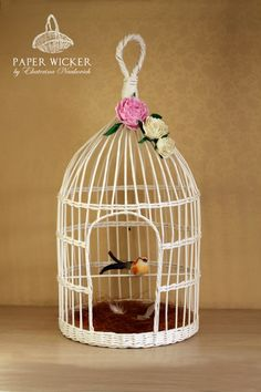 wha is it about bird cages. Newspaper Basket, Newspaper Crafts, Book Crafts, Decor Crafts, Diy Bird Cage, Bird Cages, Handmade Crafts, Diy And Crafts, Arts And Crafts