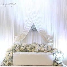 All white wedding dais..