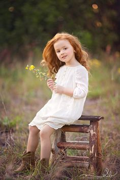 This is probably what my child would look like, that would probably be the kind of red hair she'll have. A mixture of fiery red from me and dirty blonde from my husband. She's so beautiful!