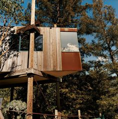 Release your inner child by hanging around a modern tree house.