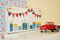 Vintage wood sign - houses with bunting, toys car   by Dream Machine Works  www.dreammachineworks.com