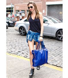 Miranda Kerr  A mix of denim and studded details gives Kerr's ensemble a grunge twist. The model wears T by Alexander Wang's Classic Pocket Tank ($80) in Black with Ksubi cutoffs, a Burberry shirt tide around her waist, Chloe Susanna Studded Leather Ankle Boots ($1345), and a Valentino bag. Want to get the look? Continue reading to shop some grunge-inspired picks!  Photo: Wagner AZ