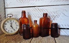 Vintage Amber Bottles - gorgeous grouped together Amber Bottles, Old Bottles, Sticks, Greenery, History, Etsy, Vintage, Historia, Vintage Bottles
