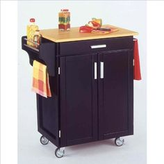 Home Styles 9001-0041 Small Cabinet Kitchen Cart by Home Styles. $240.08. Finish:Black, Top Finish:N/A, Top Material:Wood   Hardware included  Twocabinet doors with adjustable shelf inside; utility drawer  Built in spice rack with towel holder on one side  Stainless steel towel holder on the other side  Heavy duty locking rubber casters  Internal dimensions: BackToFront: 23.25' - Height: 23.5' - Width: 23.25'. Save 33% Off!
