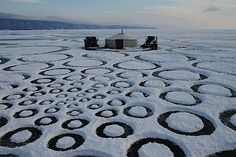 In 2010, Jim Denevan made the largest piece of artwork in the world on the surface of Lake Baikal in Siberia, a nine-mile spiral of circles over the ice using snow as/in art.