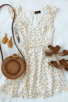 Sundress season is here and this white floral skater dress is perfect for summer. Yellow, red, and green flowers dance across the v-neckline, ruffle White Skater Dresses, Floral Skater Dress, Shift Dresses, Summer Floral Dress, Look Fashion, Teen Fashion, Fashion Outfits, Dress Fashion, French Fashion