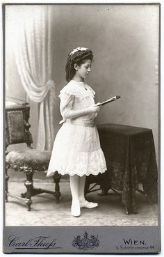 Vintage Photo of a girl posed reading a book......