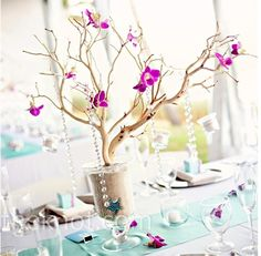 Such a money saving idea to use tree-like objects to replace big floral arrangements, take up space, add unique touch, fun to play-up