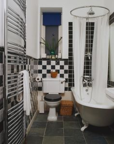 Clawfoot Tub shower with a circular shower rod.
