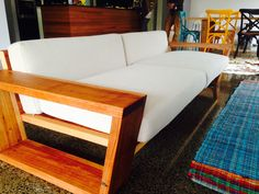 solid timber frame couch // timber couch with white cushions // bombora custom furniture