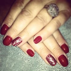 Red nails with nail art ❤