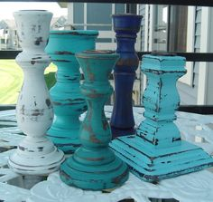 I have painted and distressed a collection of 5 turned wooden candlesticks.    A seaside color palette of blues and white.    Hand waxed finish.    Ranging in size from 5 to 7    I also have a set of 5 matching picture frames listed here... http://www.etsy.com/listing/53926830/seaside-shore-wooden-frame-collection    I will combine shipping with my other items. Email me with your zip code for a combined shipping quote.