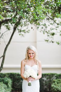 Outdoor Bridal Portrait With Strapless Lis Simon Wedding Dress And White Floral Bouquet