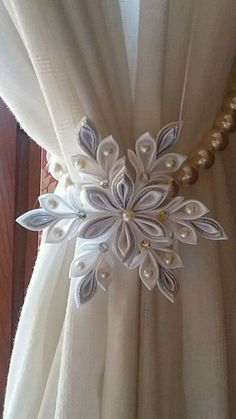 White flower appliqué with Classic pearls makes this pullback a work of Art for any drapes or curtains Гардины, Цветы Канзаши, Подхват… Ribbon Art, Diy Ribbon, Ribbon Crafts, Paper Crafts, Kanzashi Flowers, Diy Flowers, Fabric Flowers, Paper Flowers, Organza Flowers