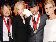 Keith Urban and Nicole Kidman - & Tim McGraw and Faith Hill. What a fab pic!! :)