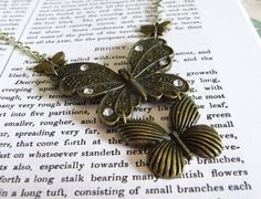 Briony Butterfly Necklace assemblage of 4 butterflies with rhinestone and very pale green chain.