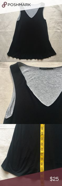 """Capote Black/Grey Layered Sleeveless Top, Large This relaxed top from Capote is a sleeveless tunic-length double-layer tank. A black shell overlays a slightly shorter gray layer. V-neck. Fabric is a 96% rayon & 4% spandex, which has a nice weight that hangs in a flattering way. Length is 29"""".  Style No. C2MACY Size: Large Condition: Excellent, no flaws. Capote Tops Tunics"""