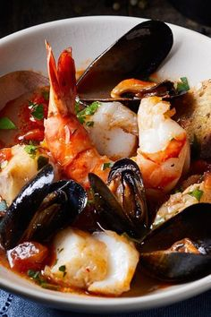 This Fisherman's stew recipe is loaded with cod, shrimp, and mussels and will warm you right up on cold winter days. The crostini served alongside are made with homemade roasted garlic, and perfect for soaking up every last morsel of the stew. Fish Recipes, Seafood Recipes, Soup Recipes, Cooking Recipes, Healthy Recipes, Dinner Recipes, Mussel Recipes, Cheap Recipes, Garlic Recipes