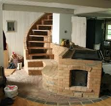 Masonry stove with cast iron cooktop; mass could include bench and stairs