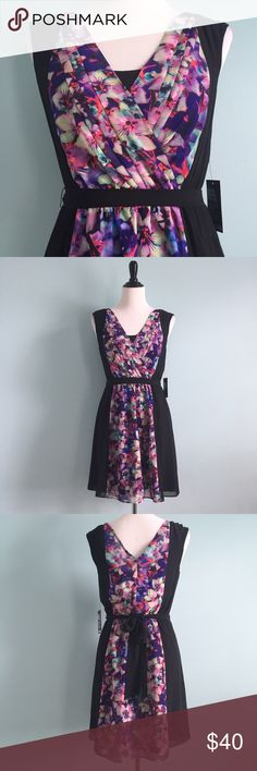 NWT Express Orchid Dress Beautiful black dress with orchid-printed sections. Shades of purple, pink, and blue. Lined with black lining. Deep V-neck. New with tags. Perfect condition. Size small by express. Feel free to make an offer! Express Dresses