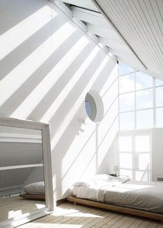 Stunning bedroom! In love with all the white and the big windows