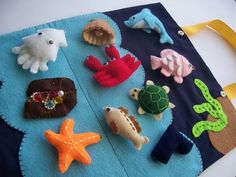 "A felt fishing game.  I'm not sure how the rods ""catch"" the fish but what a great idea for keeping them quiet and busy."