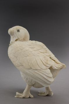 Standing with neck turned preening its right wing, with inset mother of pearl eyes.        Provenance: Heinz Collection  This piece @ H.M. Luther Antiques  The Carlyle  35 East 76th Street  New York, NY 10021