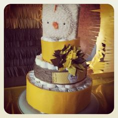 Soon to bee a family of three baby shower diaper cake. With board book topper and tissue paper flower.