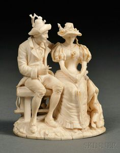 Carved Ivory Figural Group, 19th century, of a man and woman on sitting on a bench with a dog at their feet, ht. 3 1/2 in.