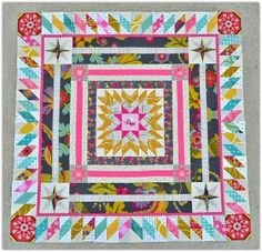 Love the outer diamond border. travelling medallion quilt by sewing sisters uphome